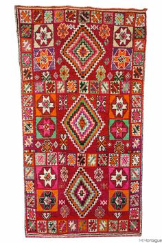 If you love Moroccan decor, this Moroccan carpet might be the one for you! Absolutely stunning Moroccan patterns. Entirely covered with Moroccan tribal symbols. Such a joyful and incredible Moroccan rug. Available at Maryam Montague's online Souk!