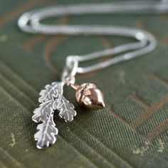I've just found Leaf And Acorn Necklace. A sweet necklace with a sterling silver oak leaf pendant and rose gold plated acorn.. £49.00