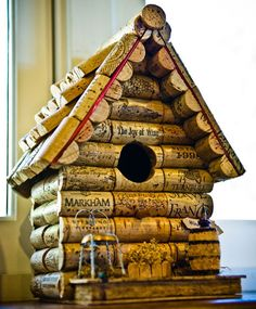 Wine Cork Bird House or Fairy house. See the little chair made out of a champagne topper?