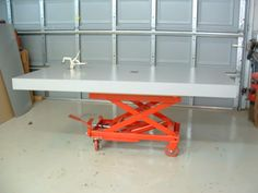 Assembly Table by Allen Bookout -- Homemade assembly table constructed from MDF and mounted on a hydraulic scissor lift table. http://www.homemadetools.net/homemade-assembly-table-10