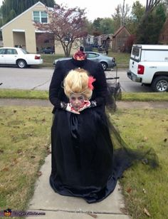 Lisa: I used a roller backpack as the extention to the upper torso. Secured a upper torso mannequin and dressed it in the black blouse and attached bloody gloves to the...
