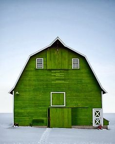 Common gambrel style roof.  The bright green with the snow white ground and blue sky is just gorgeous!