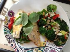 Sea Bass on a bed of samphire, roasted baby tomatoes and capers with broccoli, chilli and garlic topped with flaked almonds