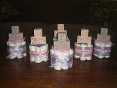 Pink and Purple Baby Shower Centerpieces. Can probably make myself. Maybe add a Winnie the Pooh baby and friends on top instead of blocks or add the WTP blocks?  bearbottomdiapercakes, $9.99