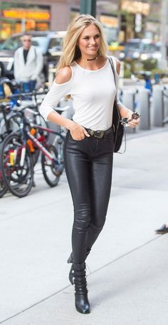 http://www.slant.co/topics/4615/compare/~paige-denim-verdugo-coated-ultra-skinny-ankle-jeans-black-silk_vs_express-black-coated-mid-rise-jean-legging_vs_mango-skinny-coated-jean  Romee Strijd's model-off-duty style was on perfect display when she went to her Victoria's Secret fashion show fitting: a white open-shoulder shirt, black skinnies, and a cool belt