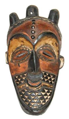 Bena Biombo Mask - Congo.  The Biombo are related to the Kete. Such masks, with an influence of the eastern Pende in the pattern of black and white triangles, were worn in circumcision rites.
