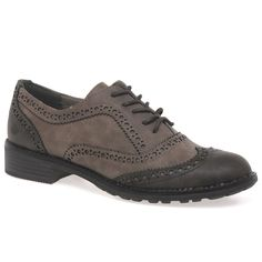 The Marco Tozzi Duchess women's brogues arrive in a choice of tobacco grey or black leathers, with contrasting toe caps and heel panels. Lace fastening, they stand on a low stacked heel.