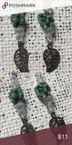 Carved Jade Rose Swarovski Crystal Dangle Earrings These Beaded Dangle Earrings feature carved jade roses, Swarovski crystal beads, and silver plated leaf charms.  They are approximately 3 inches tall, including the bronze plated earring hooks. Jewelry Earrings