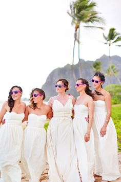 Not sure what's cooler, this bridesmaid sunglass op or this stunning Hawaiian backdrop. Hawaiian destination wedding full of colorful details Pastel Bridesmaid Dresses, Yellow Bridesmaids, Wedding Bridesmaids, Hawaiian Destination Weddings, Hawaii Wedding, Convertible Wedding Dresses, Hawaii Dress, Wedding Colors, Wedding Yellow