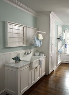 """Rainwashed"" by Sherwin-Williams. I LOVE the pull-out drying things too."