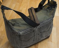 Make a Beautiful DIY Camera Bag from a Pair of Recycled Jeans and an Old Laptop Bag - http://thedreamwithinpictures.com/blog/make-a-beautiful-diy-camera-bag-from-a-pair-of-recycled-jeans-and-an-old-laptop-bag