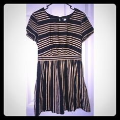 H & M brand striped dress Tan and black striped dress. Great for fall wedding or worn with leggings and booties! H&M Dresses