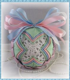 Quilted Star Ornament in soft pastels,with braided ribbon band, and crochet star center. $22.00, via Etsy.