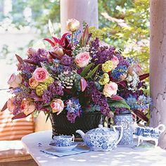Unexpected light green blooms highlight the darker hues of this arrangement.