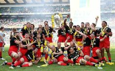 Saracens players celebrate with the trophy after the Aviva Premiership final match between Saracens and Exeter Chiefs at Twickenham.