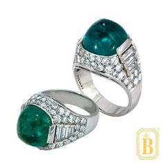 De Boulle Estate Collection ring by Bulgari featuring a sugarloaf cabochon emerald in a platinum Art Deco mounting sprinkled with Diamonds.