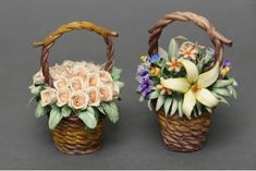 Gracious basket Centerpiece of flowers in Capodimonte porcelain finely worked. Each flower is reproduced in detail by the artist and it is then laid on an elegant basket, which is also entirely woven by hand.        (Price is intended for one basket. Please indicate your preference, left or right, when ordering).        Dimensions cm. 12x9