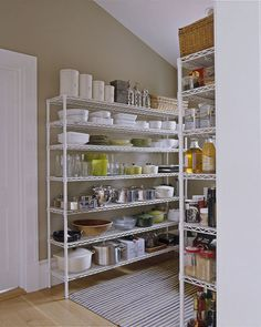 In the pantry, simple wire Metro shelving holds plates, props, and supplies.