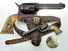 The Colt Single Action Army which is also known as the Single Action Army, SAA, Model P, Peacemaker, M1873, and Colt .45 is a single-action revolver with a revolving cylinder holding six metallic cartridges. It was designed for the U.S. government service revolver trials of 1872 by Colt's Patent Firearms Manufacturing Company – today's Colt's Manufacturing Company – and was adopted as the standard military service revolver until 1892. From Wikipedia, the free encyclopedia.: