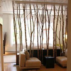biombo reciclado con ramas de árbol