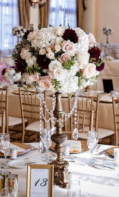 20 Burgundy Wedding Centerpieces Tall burgundy and blush wedding centerpieces Winter Table Centerpieces, Blush Wedding Centerpieces, Wedding Decorations, Centerpiece Flowers, Centerpiece Ideas, Burgundy Floral Centerpieces, Candelabra Centerpiece, Table Flowers, Table Decorations