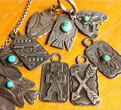Vintage Native American sterling silver and turquoise, key fobs, pendants and brooches. Thunderbirds, arrows, animals, etc.