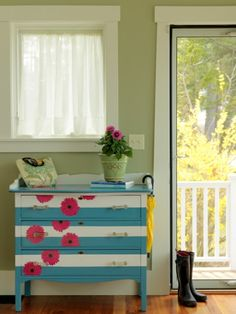 I love the spray of flowers on this bright dresser.  I have just the one to update like this