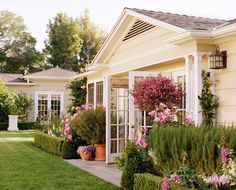 Love the landscape design around this California cottage used as a backyard bistro.  (Schuyler Samperton Interior Design)