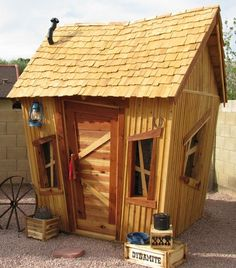Cowboy Condo Luxury Outdoor Playhouse  - The boys would go NUTS for this!