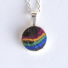 Sterling silver custom felted pet hair cabochon pendant with sheep's wool colour accents. It is made with your pet's hair and made, with love, by Small Saints!