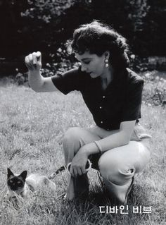 Vivien Leigh plays with her cat, late 1940's.