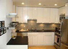 (Foto: Divulgação) #cozinha #clean #inox #prateleiras #iluminação