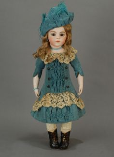 """20"""" Bru Jeune 7 - Offered by the Carmel Doll Shop - Costumed in the classic Bru style in aquamarine silk faille, wearing a matching chapeau, an assortment of jewelry in turquoise beads, and antique leather boots. Price $23,500"""
