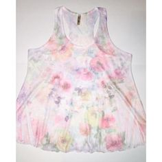 Bella D Floral Tank Top Bella D brand- White and pastel floral sheer fabric tank. Loose fitting swing style top. Racer back cut. Raw ruffled edge hem. Very cute and perfect for spring! Size Large. Excellent condition worn once. Tops Tank Tops