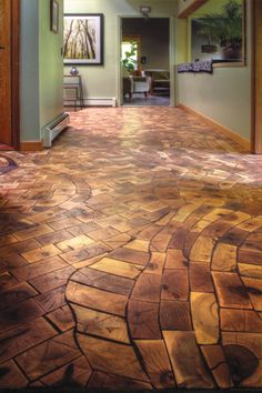 End-grain Flooring. This is stunning! love the organic curve of the lines and 'mosaicness' of the flooring.