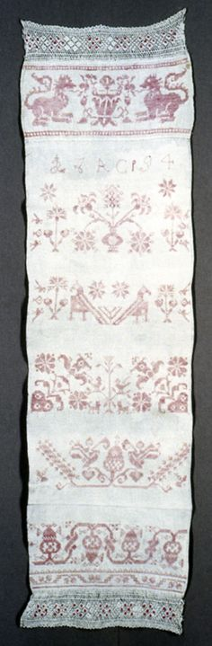 "Designs in style of Italian Renaissance, showing confronted lions, vases of flowers, addorsed birds, and conventionalized floral patterns arranged as cross borders. Edged, top and bottom with bobbin lace ornamented with red cotton dot.    This towel is medium: cotton, linen technique: cross stitch. Its dimensions are: Warp x Weft: 26 x 36 cm (10 1/4 x 14 3/16 in.).    This towel is from Switzerland and dated ""1794""."