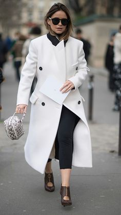 Miroslava Duma seen wearing a white coat before the Dio Fashion Show in the streets of Paris on March 3 2017 in Paris France