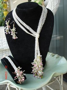 April Challenge.. Beaded Lariat (St. Petersburg Stich) Made this set in 2008.  Has a variety of charms on the Lariet and the bracelet .. GIFTED