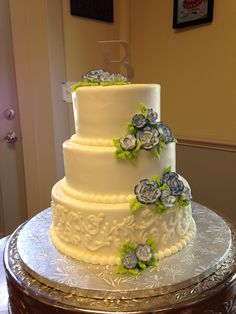 Buttercream 3 tiered wedding cake with tinted roses for a simple, but elegant, look!