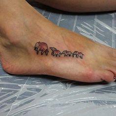 Elephants in a Line Tattoo for Elephant Tattoo Ideas