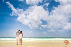 A romantic couple walk on a beautiful tropical beach during a photo session by #DreamArtPhotography at Le Blanc Resort in Cancun, Mexico. @palaceresorts