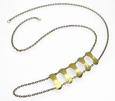 Alexis Shield Necklace by Heather Perry: Brass Necklace available at www.artfulhome.com