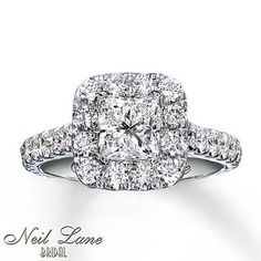 A little more low key ;) but just as beautiful! Still not 100% on princess.. wonder if they could do a cusion.. (Diamond Engagement Ring 2 ct tw Princess-cut 14K White Gold @ Kay jewelers)