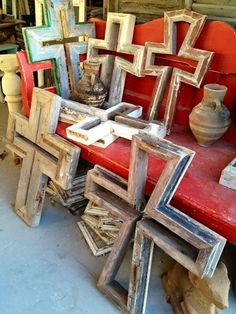 Group these in different sizes on the wall over a sideboard or behind a sofa. Biddy Craft/Crosses made from antique architectural elements.