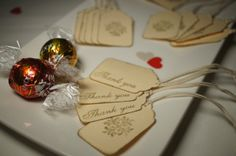 Wedding Favour Tags - Set of 50 vintage style gold and cream-coloured wedding favour tags.Favour tag have been hand punched with cream coloured 300gms card. Tags have been hand stamped and edged with gold ink and pre-strung with a natural cotton string.Tag size: 3.1cm (l) * 5.3cm (h)String length: Approx. 7.5cmCan post to anywhere within Australia and will ship within 1-2 days of payment.Tags can also be personalised with your intials. $15 aud.