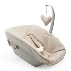 The Tripp Trapp® Newborn Set™ allows your baby to sit with you at the family table, from birth, sharing important moments and building lasting bonds with both parents and siblings.<br/><br/>What's included: Newborn Seat with upholstery in Beige
