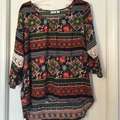 Cato patterned top Beautiful patterned top with lace in sleeves. High in the front and low in the back Cato Tops