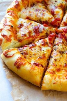 A simple recipe for gooey cheese pizza on top of a cheesy pizza crust. One of our favorite things to make for dinner is pizza. with an AWESOME crust. Cheesy Crust Pizza, Pizza Dough, Pizza Pizza, Pizza Yeast, Grilled Pizza, Deep Dish, Kids Meals, Toddler Meals, Food Porn