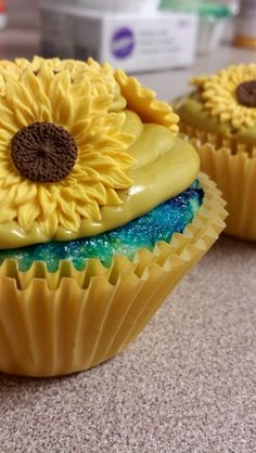 Van Gogh cupcakes I made for abrookec 's birthday today. Starry Night cake with Vase With Twelve Sunflowers icing, along with freshly picked sunflowers.