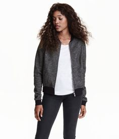 Black melange. Jacket in soft sweatshirt fabric with a zip and diagonal pockets at front and ribbing at neckline, cuffs, and hem. Soft, brushed inside.
